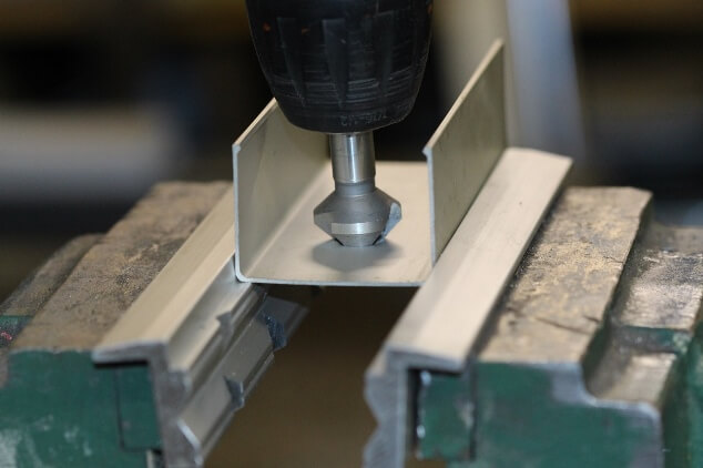 Soft jaw application: Close-up view of a clamped workpiece on the 90 degree shoulder of the jaws for countersinking